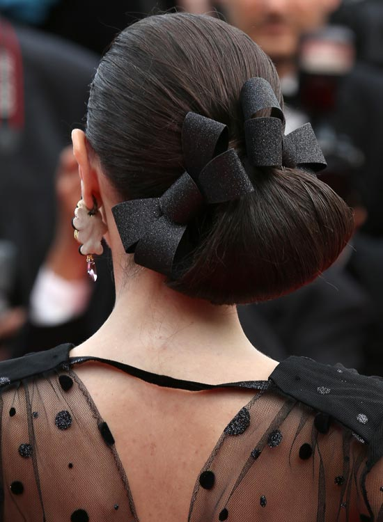 Low-Angled-Loop-Hairdo-with-Double-Bows