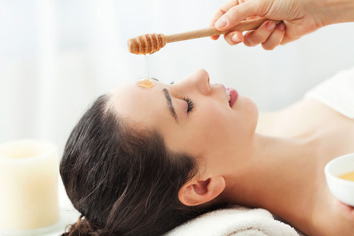 Woman-having-honey-facial-massage-at-spa-salon