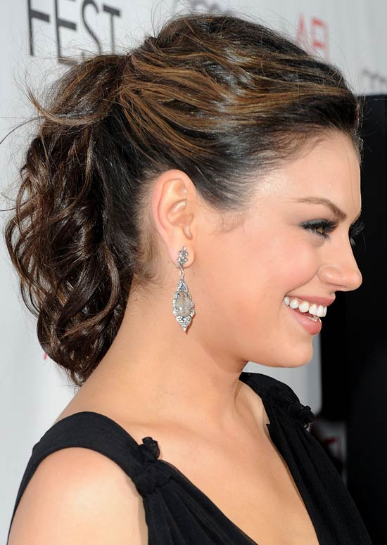 28. Messy Wavy Ponytail With Texture