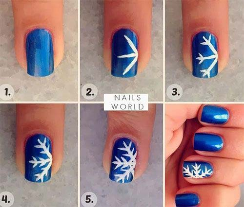 34. Blue Snowflake Christmas Nail Art