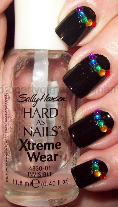 Colored rhinestone half moons nail art