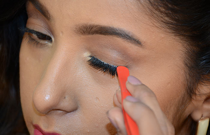 6. Secure The Lashes With Tweezers