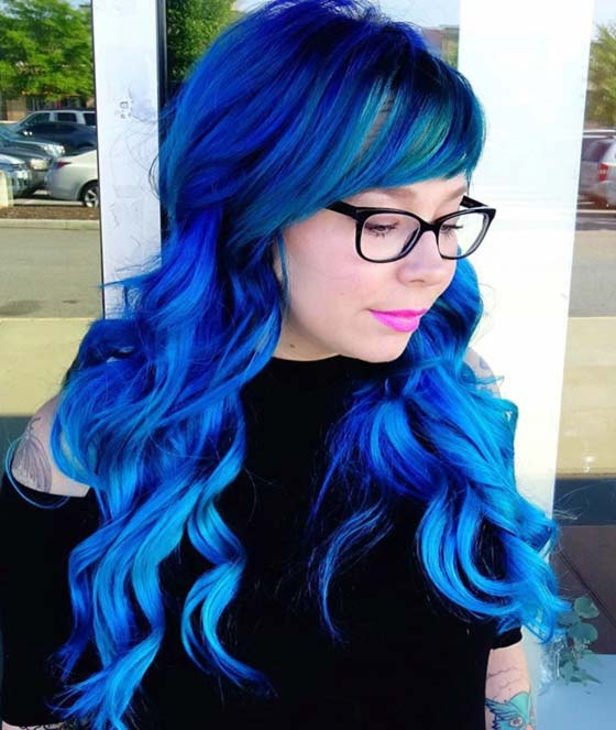 Best Layered Hairstyles With Bangs - Electric Blue Curls And Side Swept Fringe