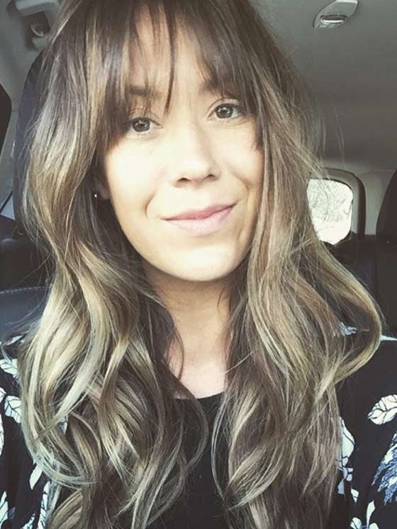 50.-Relaxed-Curls-With-Wispy-Bangs