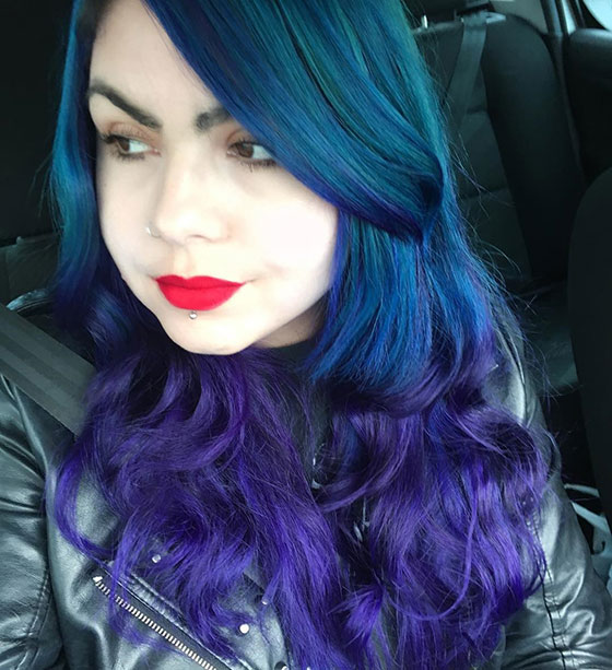 Best Layered Hairstyles With Bangs - Bouncy Blue And Purple Curls With Side Swept Bangs