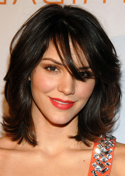 flirty medium bangs hairstyle