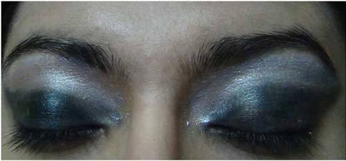 Apply a Shimmer White Shadow - Black Eye Makeup