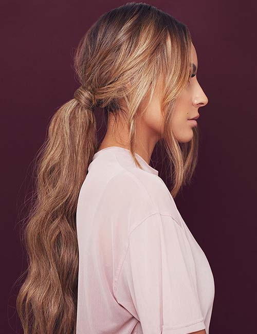 17. Beachy Waves Low Ponytail