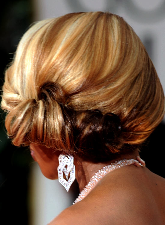 Low-Side-Swept-Rolled-Updo-with-Texture
