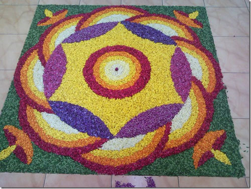 rangoli designs with petal flowers