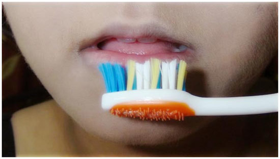 toothbrush in hot water