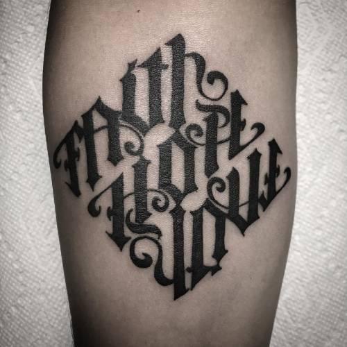 12. 'Faith-Hope-Love' Ambigram Tattoo