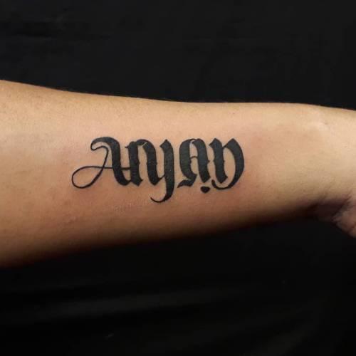 15. Dual Ambigram Tattoo