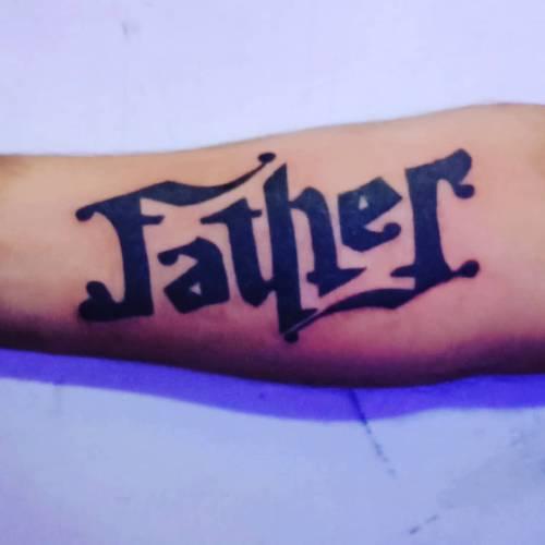 2. 'Father' Ambigram Tattoo