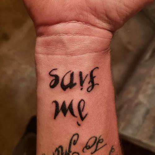 20. Contrasting Ambigram Tattoo
