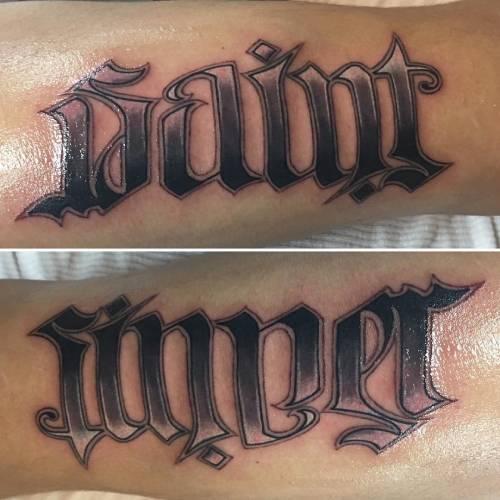 22. 'Saint-Sinner' Ambigram Tattoo