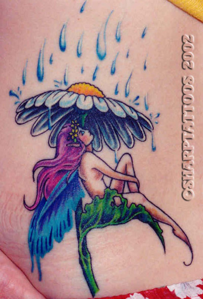 A fairy taking shelter from rain tattoo