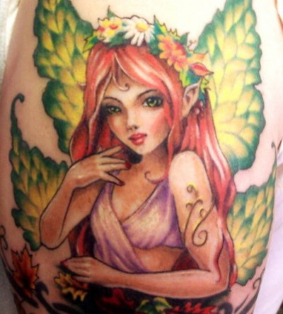 A fully coloured fairy tattoo