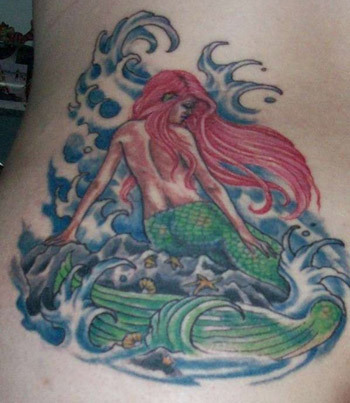 A mermaid with her back turned tattoo
