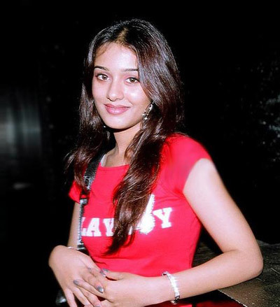 Amrita looks simple with a red Playboy T-shirt