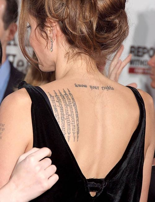 Angelina Jolie's Tattoo - Buddhist Script On The Upper Back