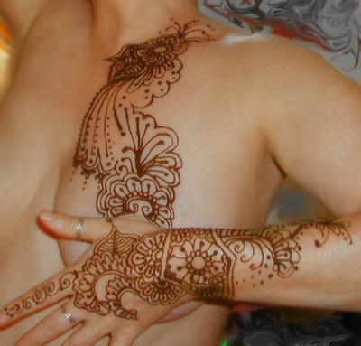 Designer breast tattoo