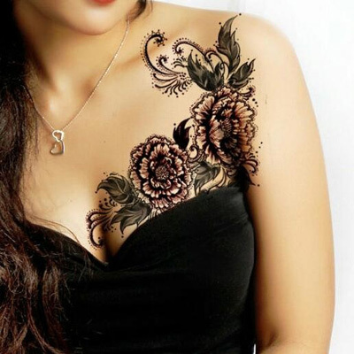 Flowery breast tattoos