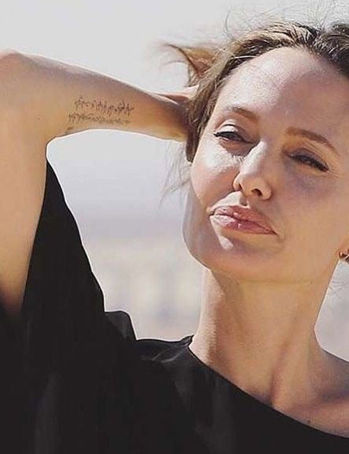 Angelina Jolie's Tattoo - Inscriptions On The Right Hand