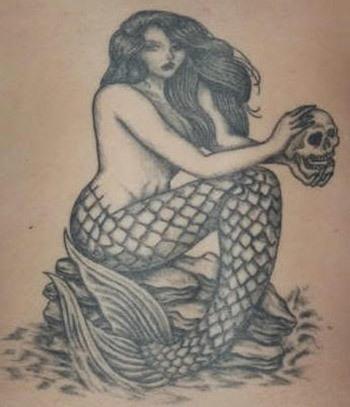 Mermaid on the rocks tattoo
