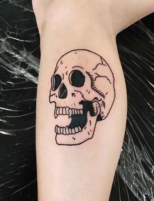 Skull Head Tattoo On Leg
