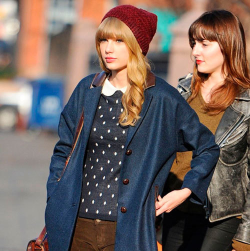 8d709452e7b Taylor Swift was spotted wearing a polka dotted shirt with brown pants. She  had on a red beanie and a navy blue blazer. She was carrying a sling bag.