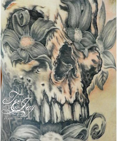 flowery skull tattoo