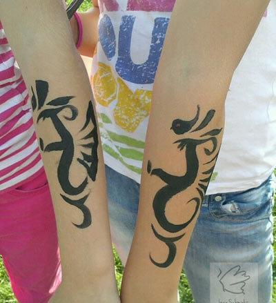 hand dragon tattoo