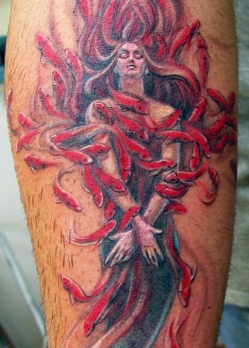 mermaid among a shoal of fish tattoo