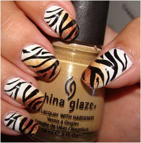 50 animal themed nail art designs to inspire you tiger nail art prinsesfo Image collections
