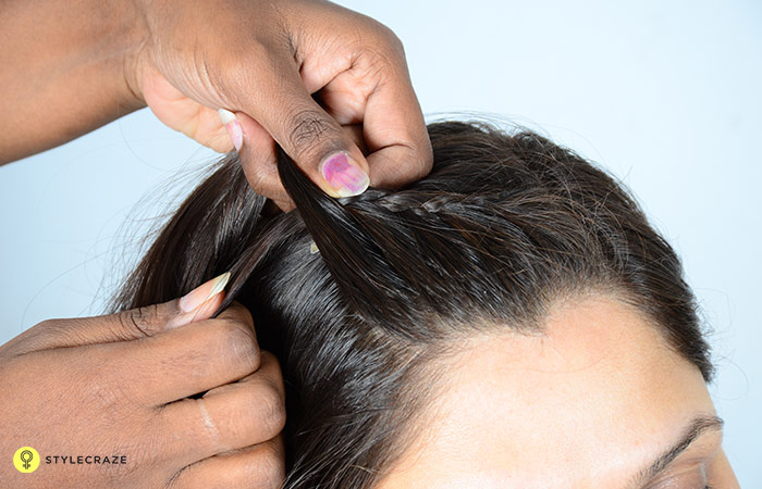 5.-Keep-adding-more-hair-with-each-stitch-of-the-braid