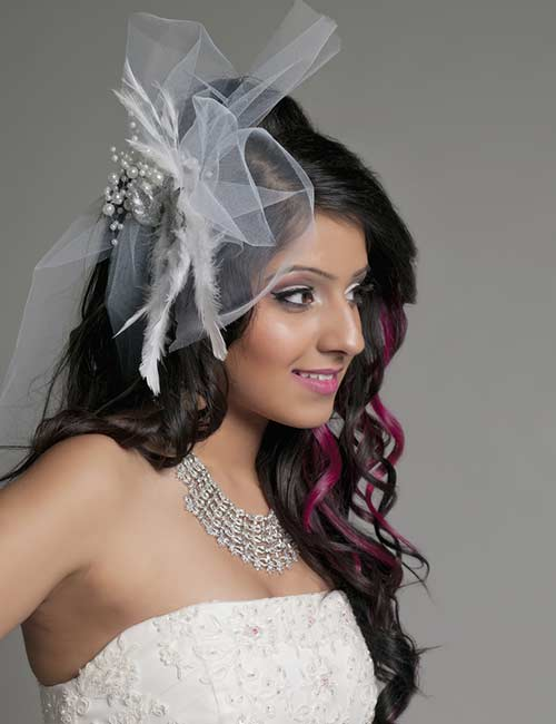 A veiled hat will make your bridal look very stylish.