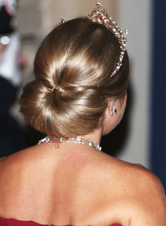 Smooth-Low-Semi-Circular-Bun-Updo-with-Puffy-Top