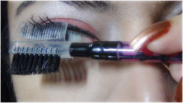 Gothic Eye Makeup Tutorial - Step 9: Brush out Excess Mascara