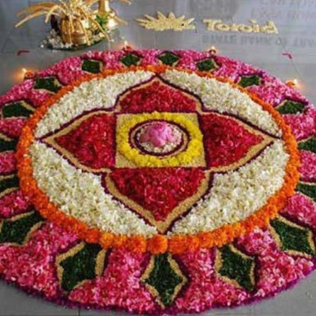 pink colored rangoli design