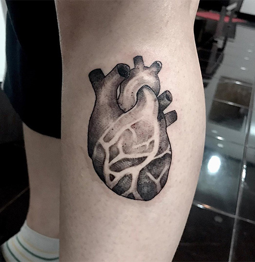 Atom Heart Tattoo On Forearm