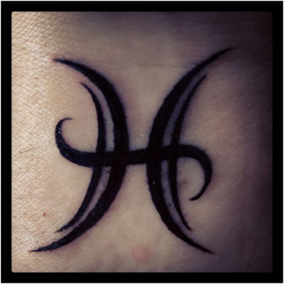Bold Black Pisces Symbol Tattoo