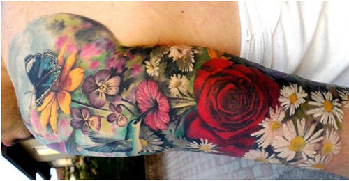 Colored Daisies Arm Tattoo