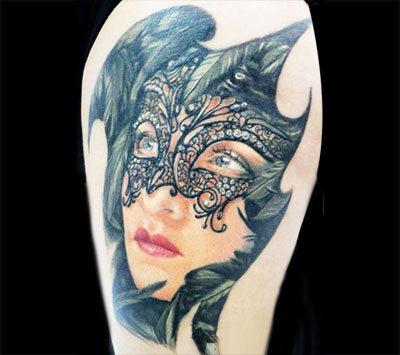 Emoticon mask tattoo