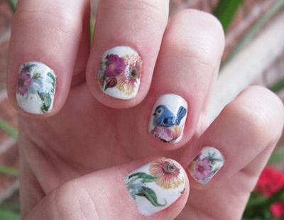 floral nail tattoo