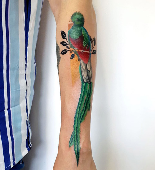 Green Bird Tattoo On The Forearm