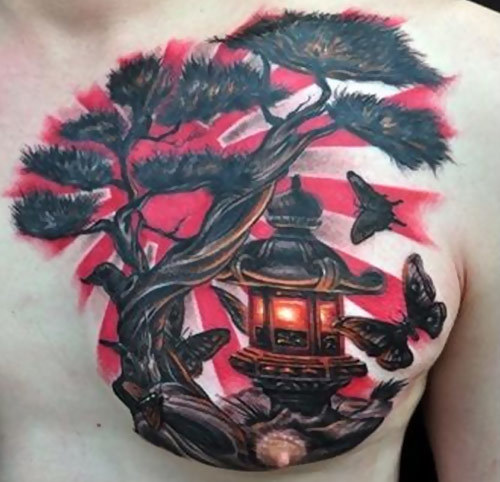 lantern on tree with butterflies tattoo