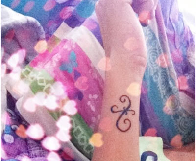 Miniature Pisces Symbol Tattoo