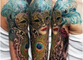 Peacock mask tattoo