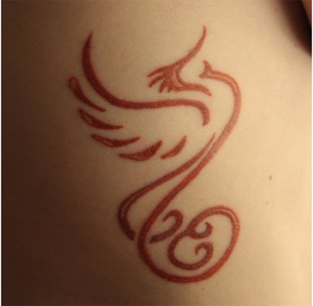 Subtle Phoenix Tattoo